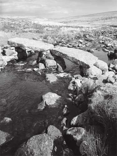 clapper bridge on the River Avon before its restoration